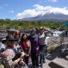 Some of the group at Petrohue waterfalls (Chile lake district with Osorno volcano in background)